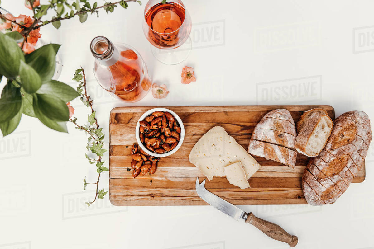 Snack board with Rosé styled on white Royalty-free stock photo