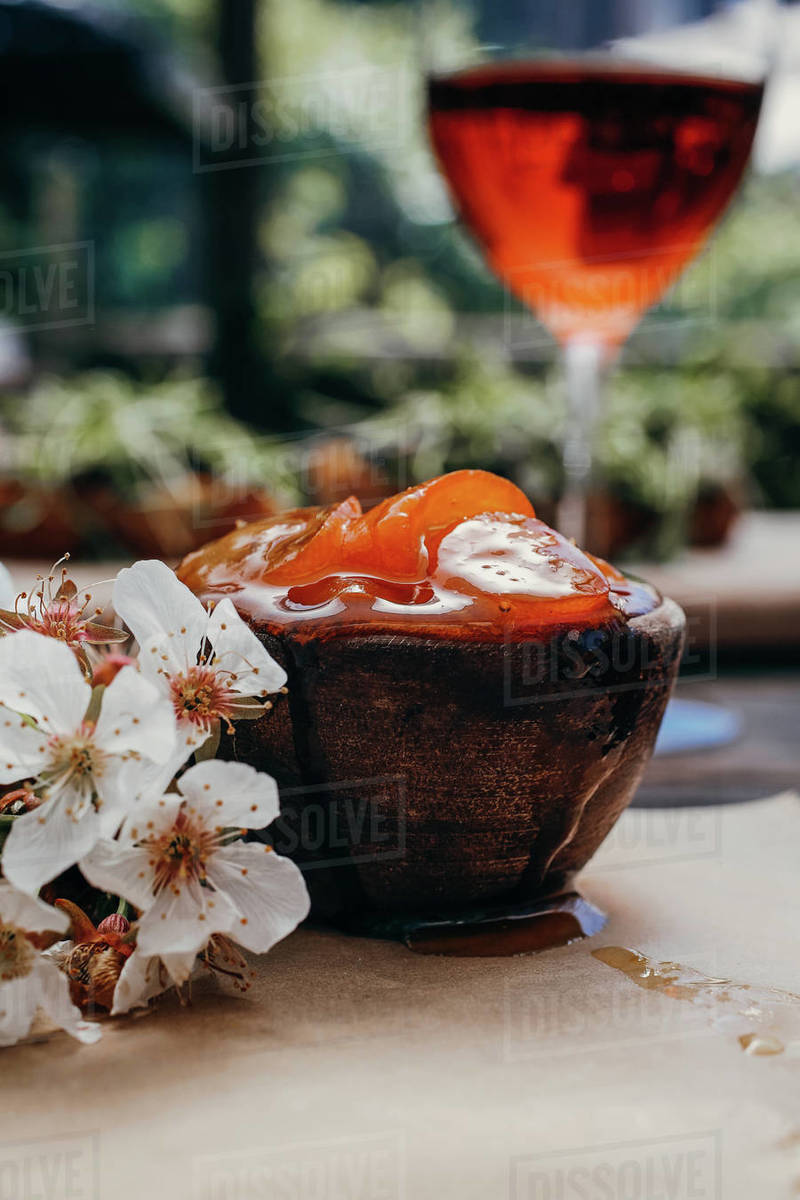 Fruit jam with wine and flowers styled Royalty-free stock photo