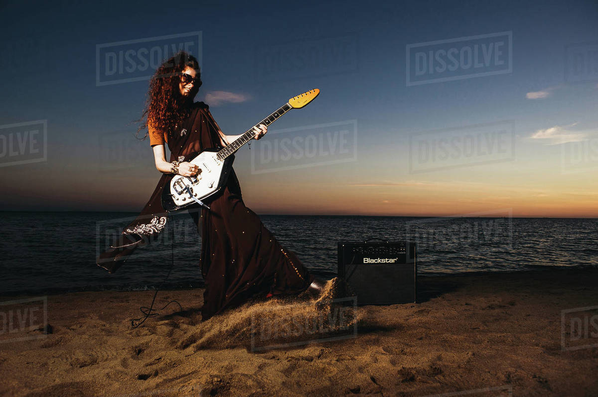 Hippie Girl with Guitar at Seabank Royalty-free stock photo