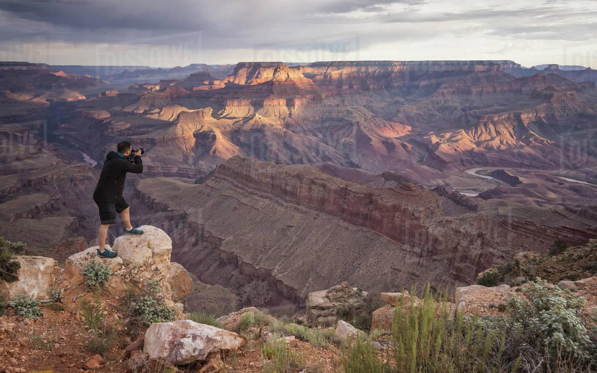 Man photographing grand canyon at sunrise Royalty-free stock photo