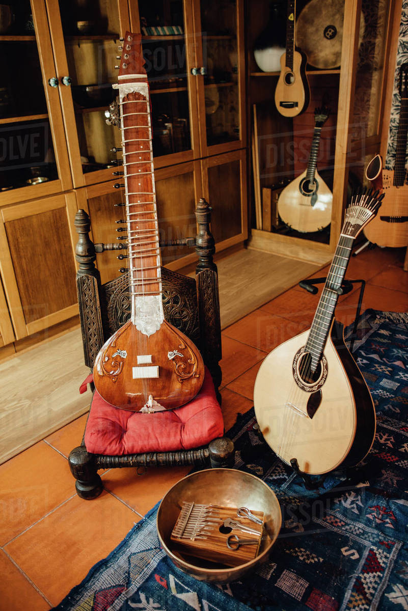 Instruments in a musical store: sitar, portuguese guitar, kalimba Royalty-free stock photo