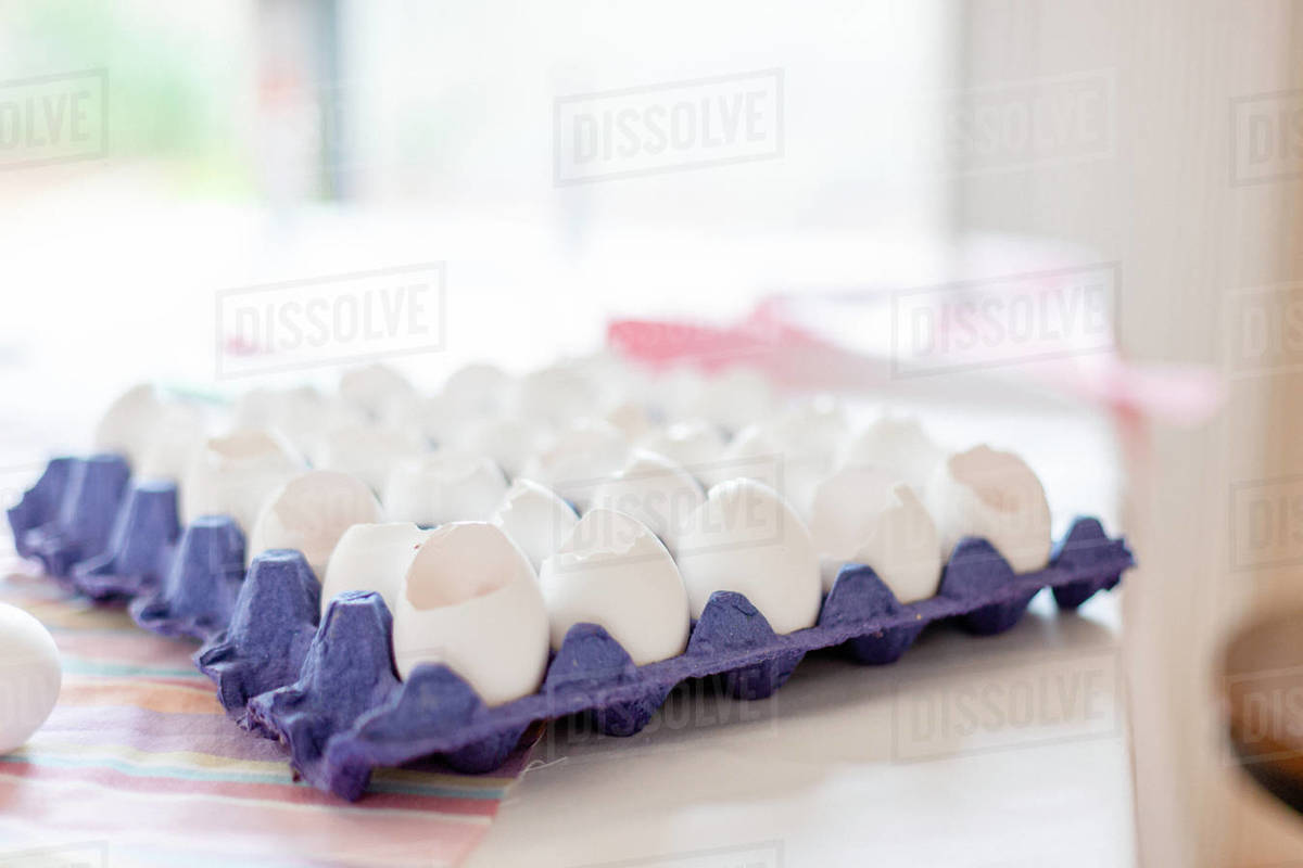 Carton open white Eggshells in kitchen while cooking Royalty-free stock photo