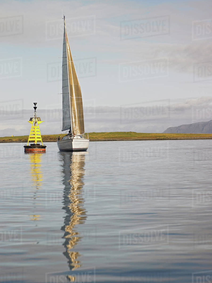 Sailboat in calm weather close to Reykjavik Royalty-free stock photo