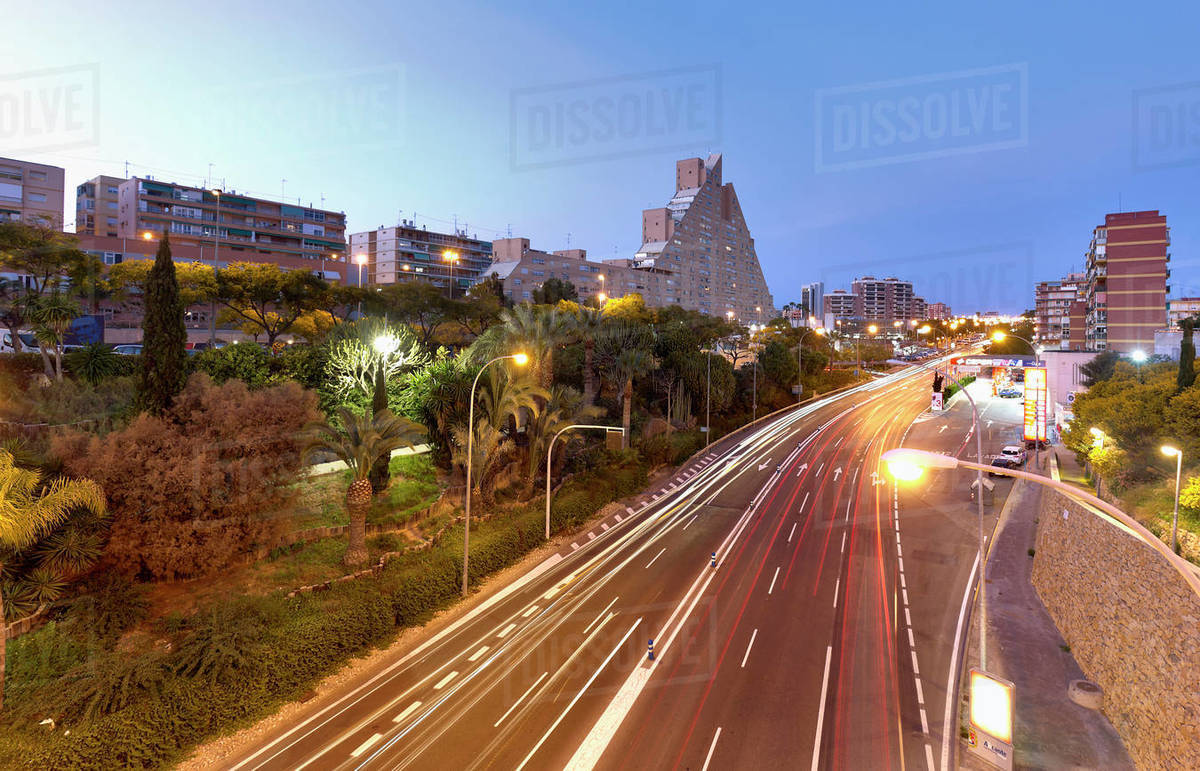 Long exposure dusk in a street with enough traffic  in Alicante. Royalty-free stock photo