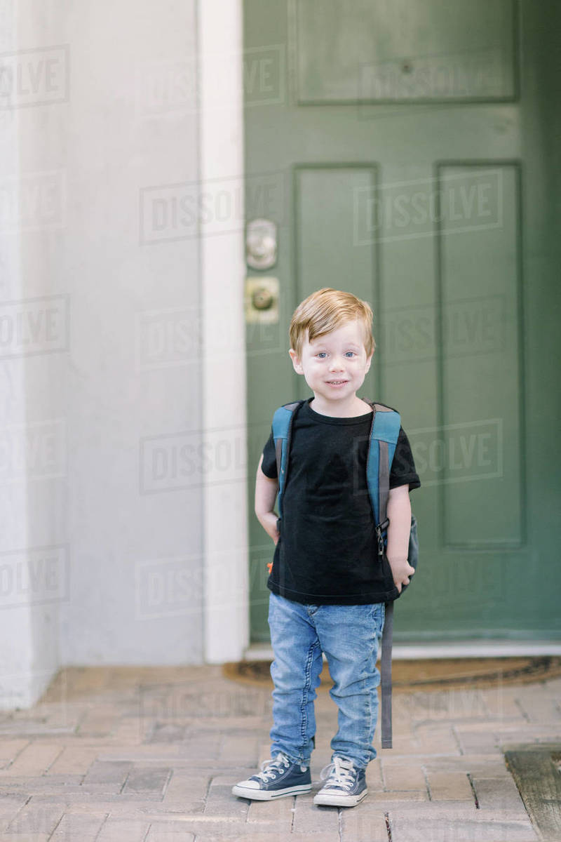 First day of preschool photo at home with backpack Royalty-free stock photo