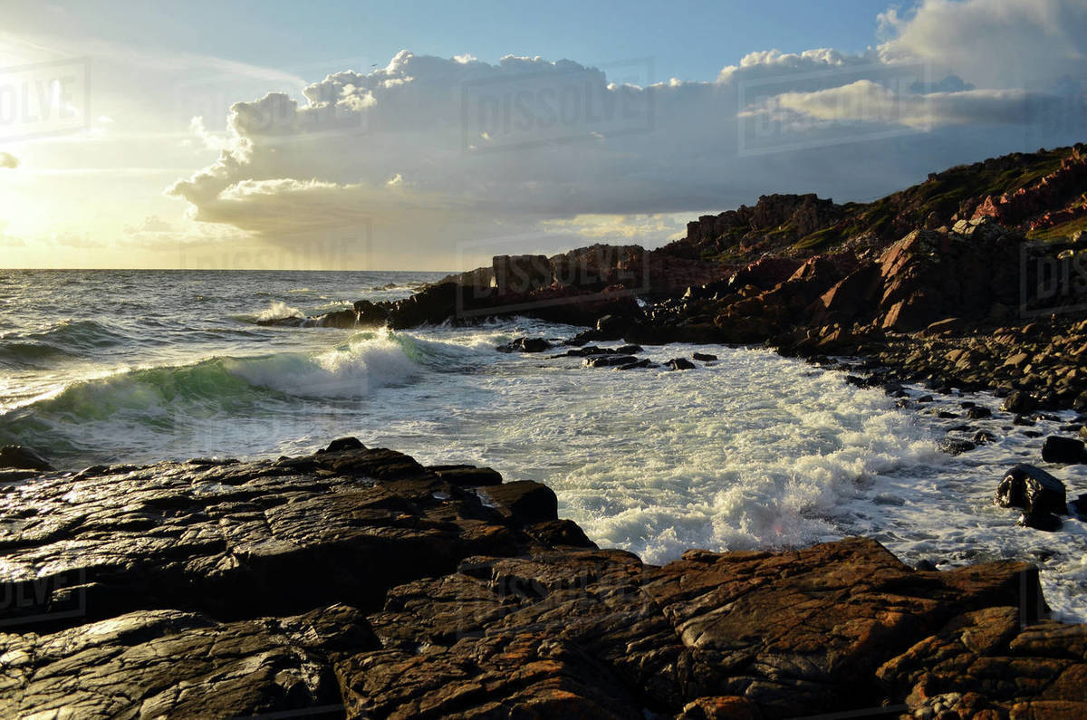 The beautiful rocky coast is taken waves on sunset Royalty-free stock photo