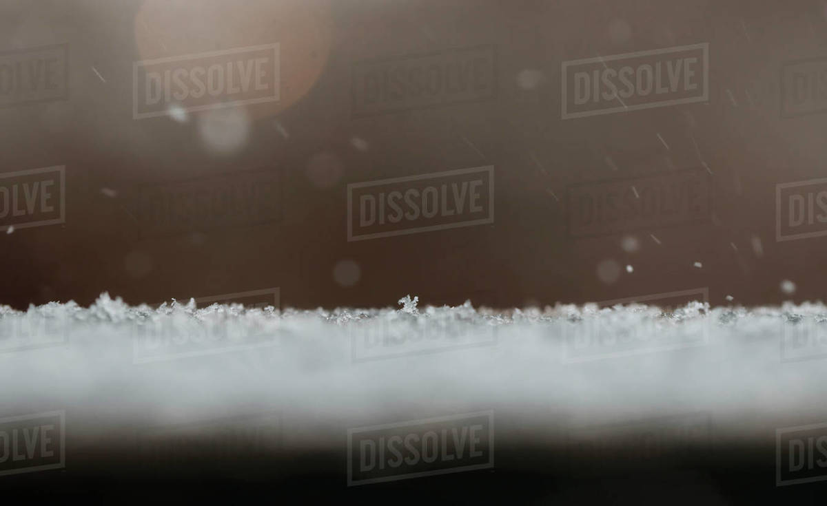 Snow flakes falling on the ground during a snow storm in winter Royalty-free stock photo