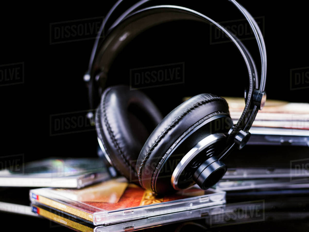 Black Hi-Fi headphones on some music CDs Royalty-free stock photo