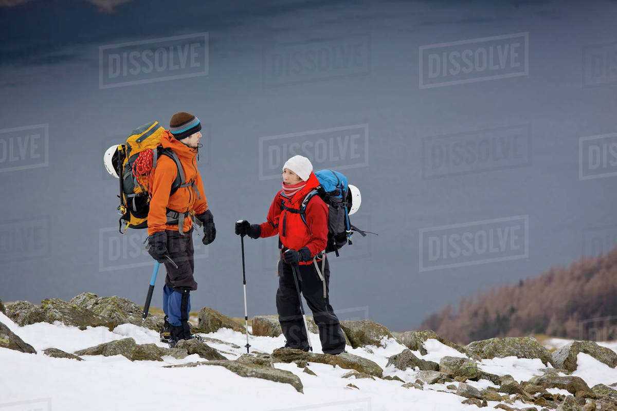 Couple hiking up Helvellyn mountain in the Lake District Royalty-free stock photo