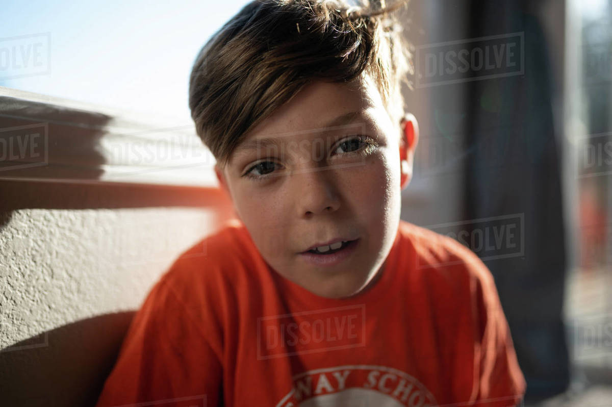 Portrait of a boy inside looking at the camera with beautiful light Royalty-free stock photo