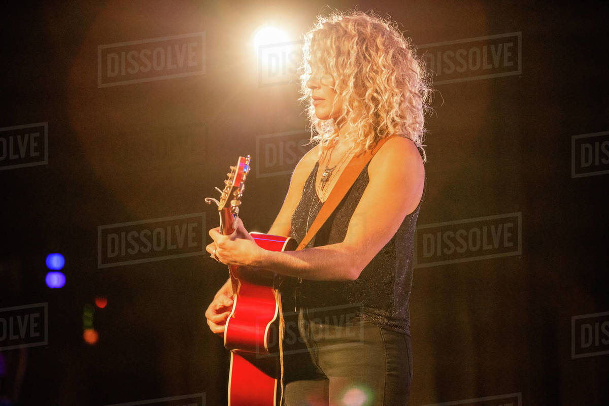 Female musician playing on stage Royalty-free stock photo