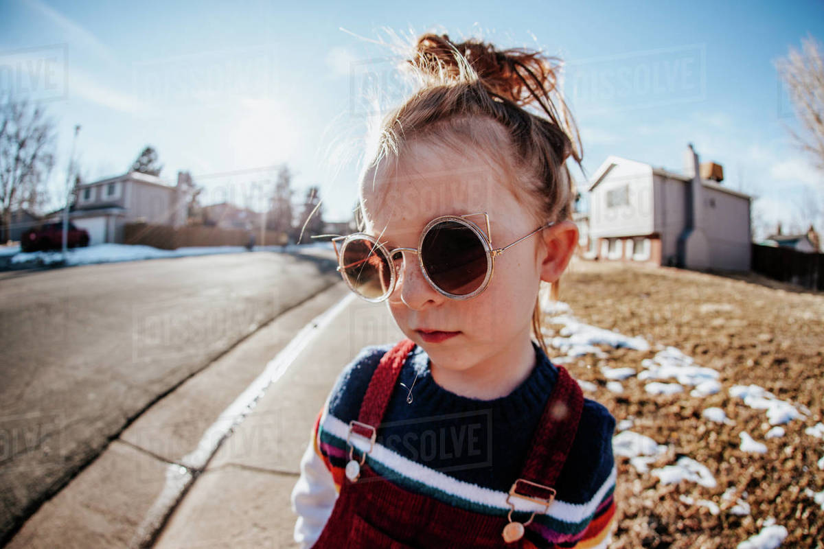 Close up of young child outside looking serious Royalty-free stock photo