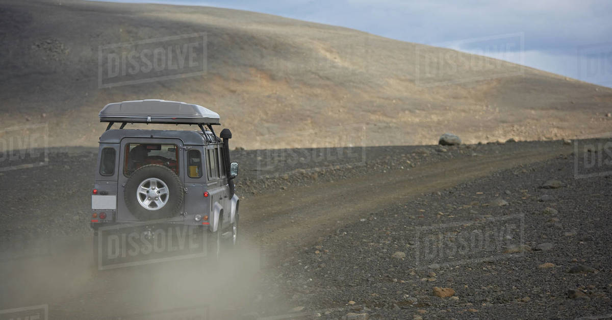 SUV driving on dusty road in central Iceland Royalty-free stock photo