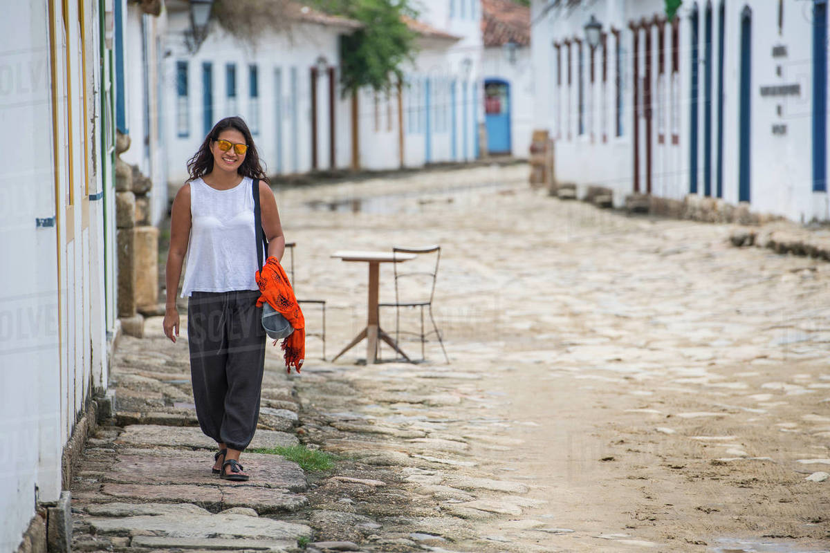 Woman walking through the streets of Paraty in Brazil Royalty-free stock photo