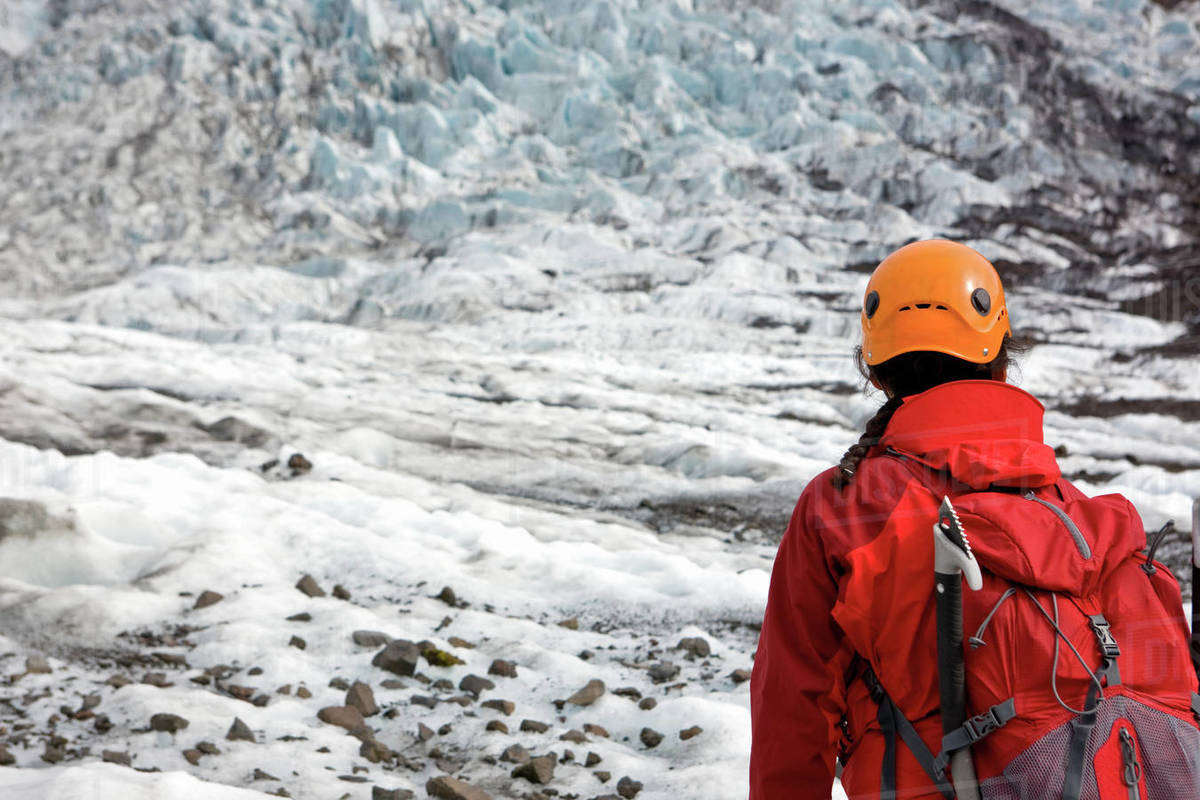 Woman hiking up Sólheimajökull glacier in south Iceland Royalty-free stock photo