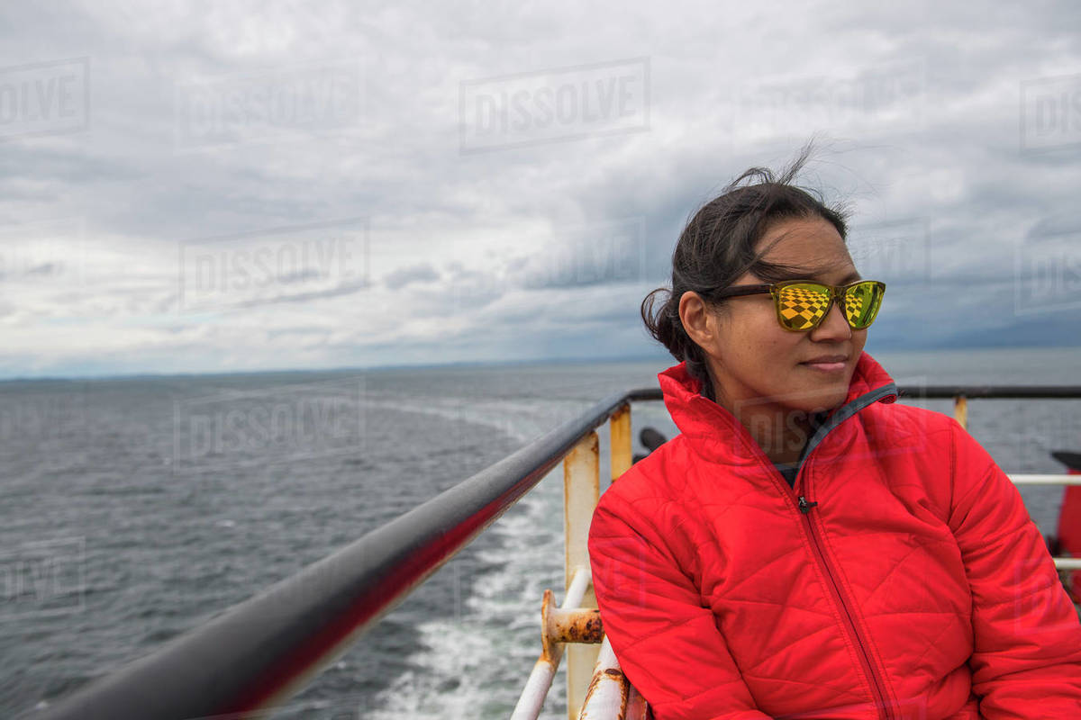 Woman relaxing on a passenger vessel traveling in South America Royalty-free stock photo