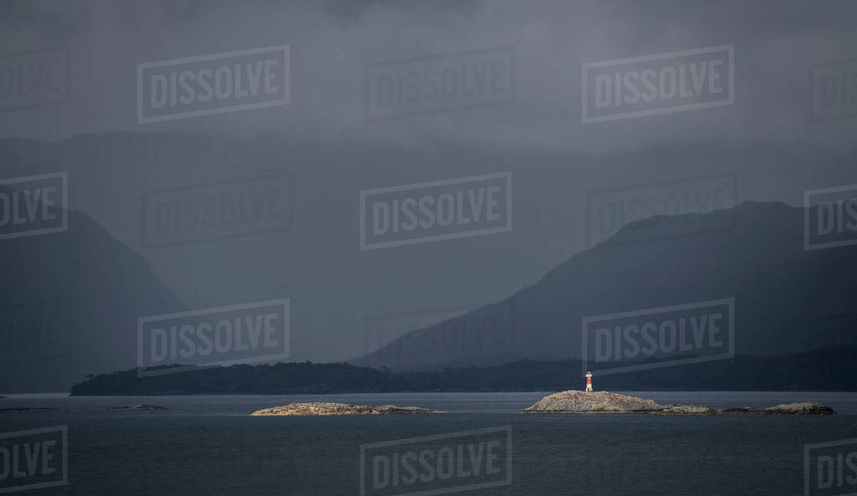 Lighthouse on a small island in the Patagonian fjords Royalty-free stock photo