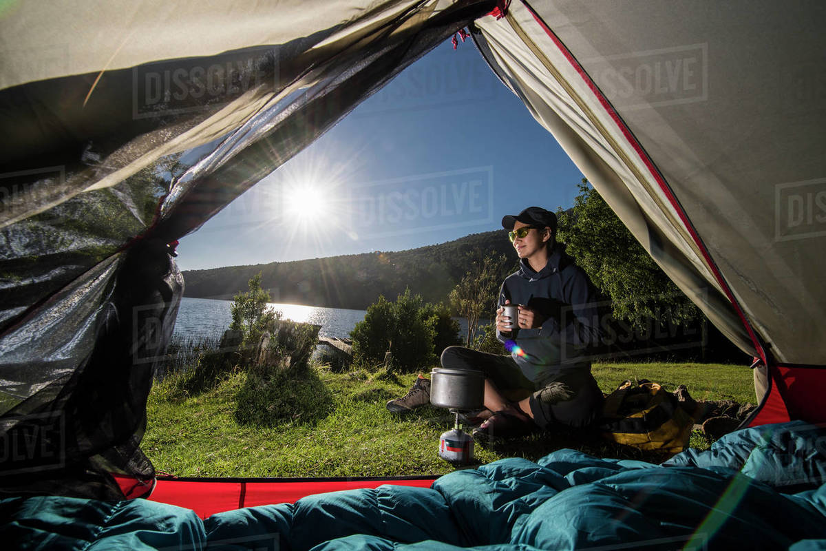 Woman camping at the Chilean lake district, Pucon, Chile Royalty-free stock photo
