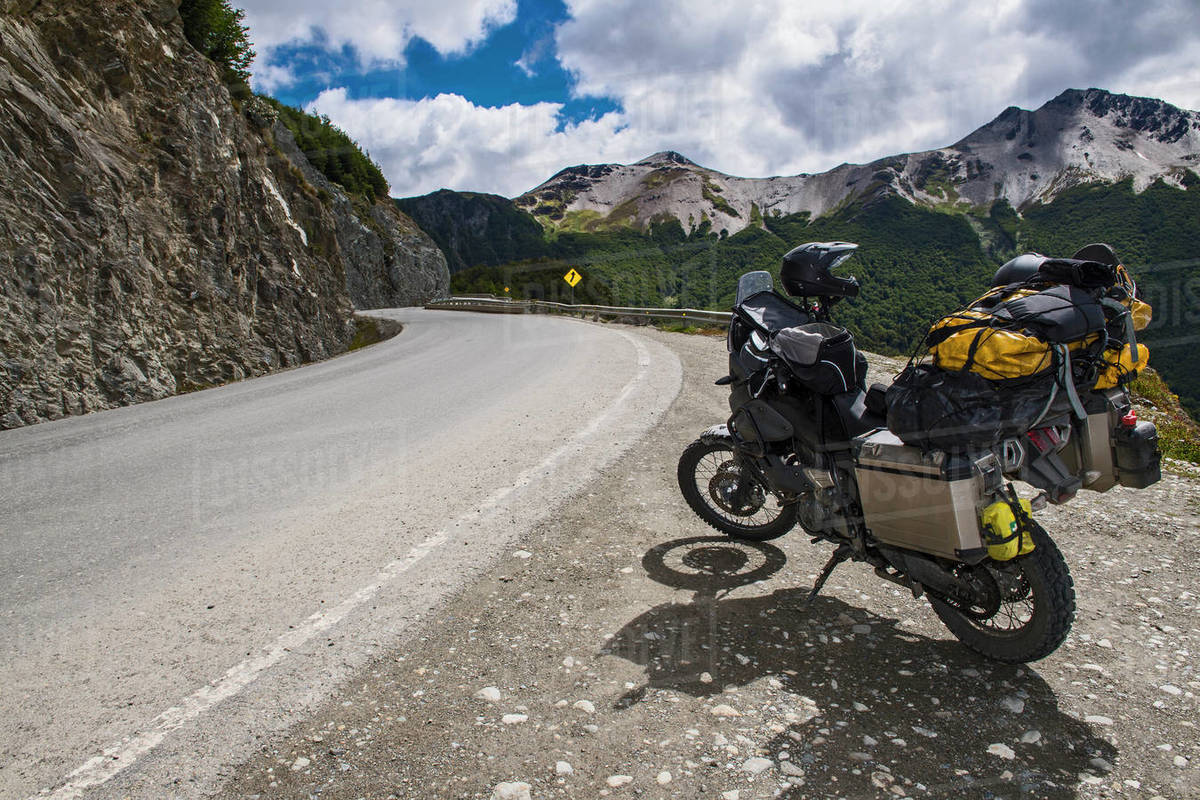 Adventure motorcycle parked beside a road in Tierra del Fuego Royalty-free stock photo