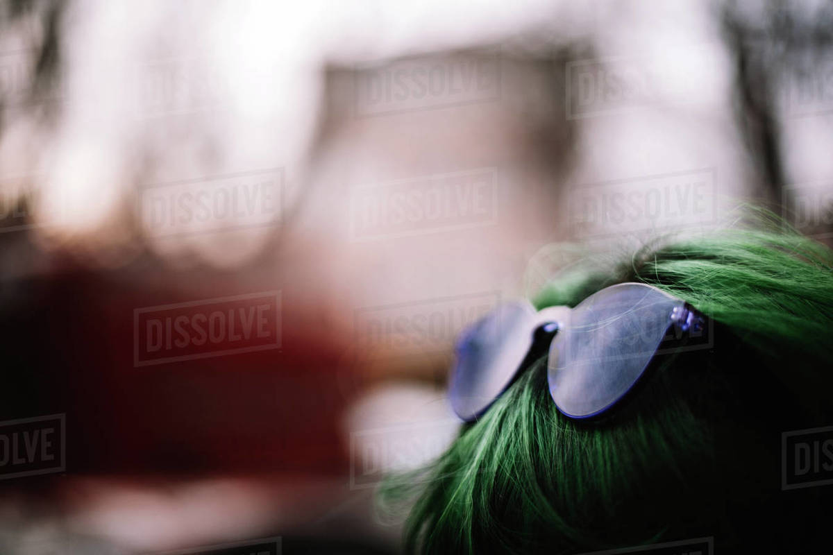 Close up of purple sunglasses on green haired head Royalty-free stock photo