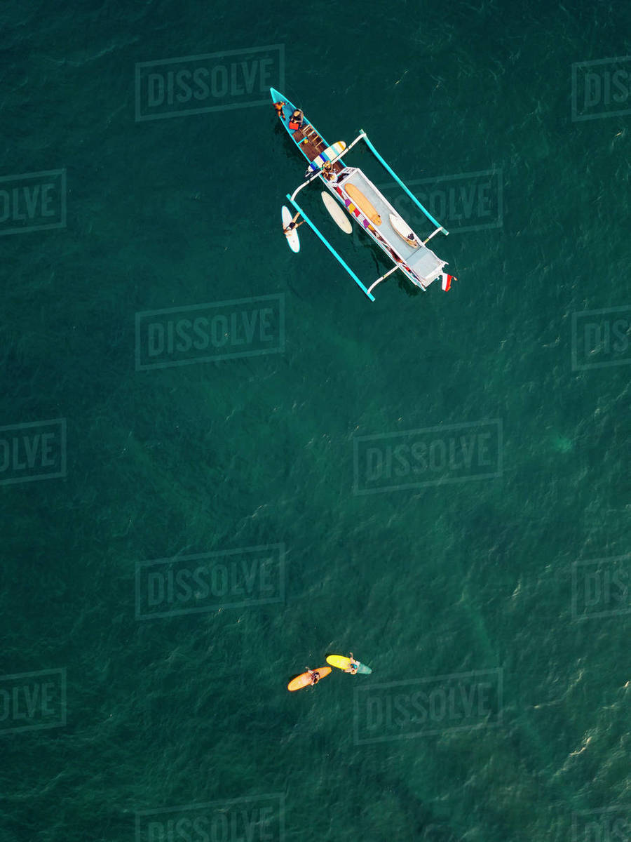Aerial view of surfers and boat in the ocean, Lombok, Indonesia Royalty-free stock photo