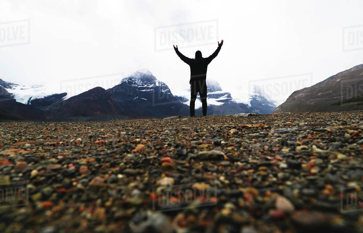 Silhouette Of Man With Arms Toward Heaven Praying On Mountain Peak Royalty-free stock photo