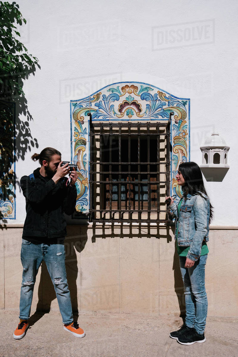 Boy taking pictures of a woman on a sunny day Royalty-free stock photo