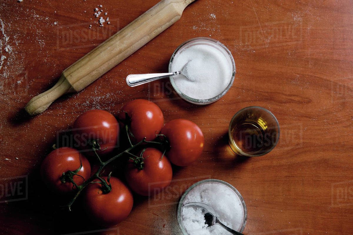 Preparing pizza base at home, we put tomato, cheese,... Royalty-free stock photo