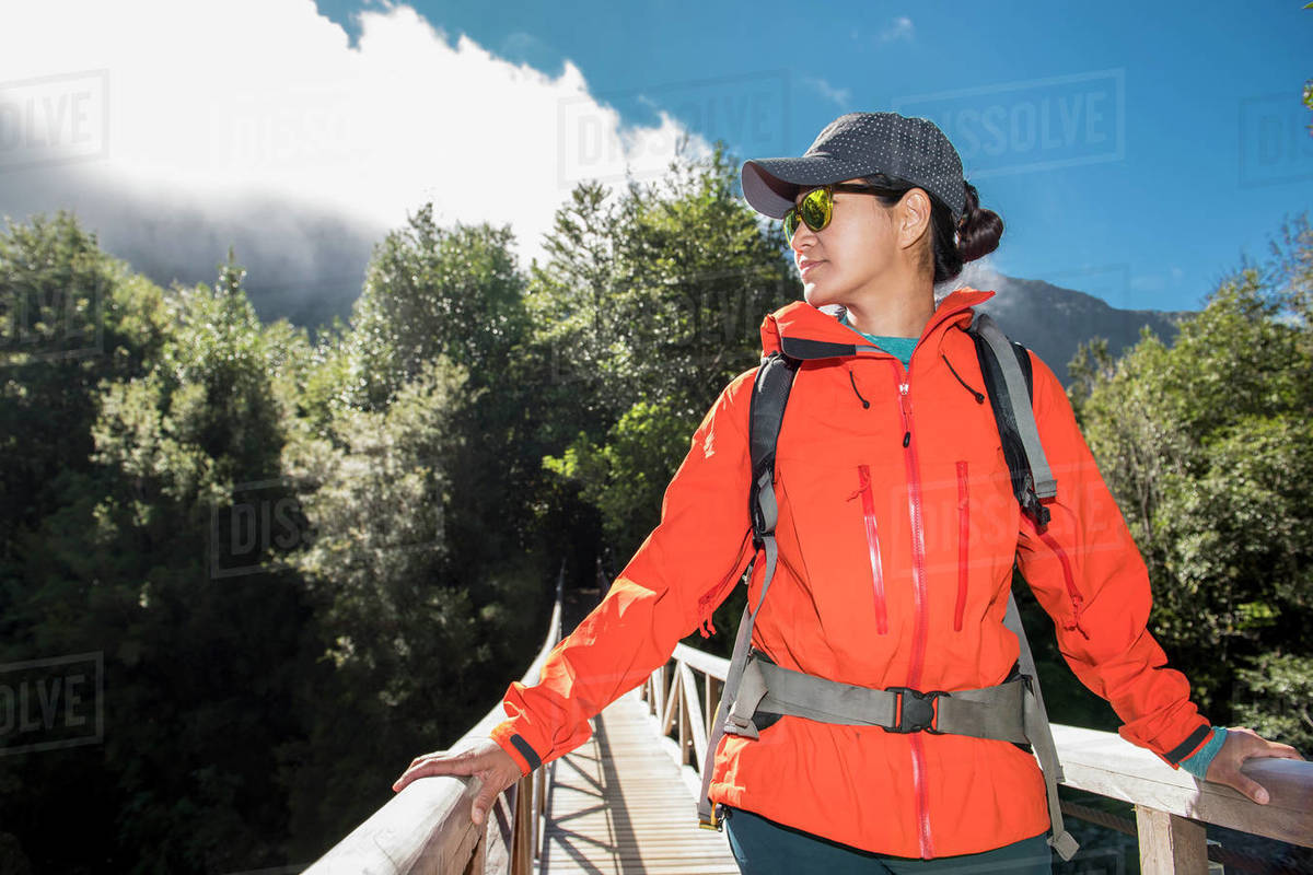 Woman crossing wooden bridge at Caleta Gonzalo in Chile Royalty-free stock photo