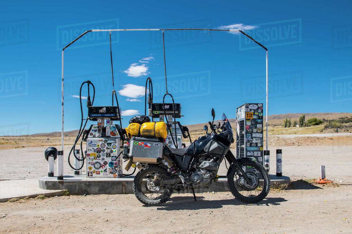Adventure motorcycle parked at petrol station in remote area Royalty-free stock photo