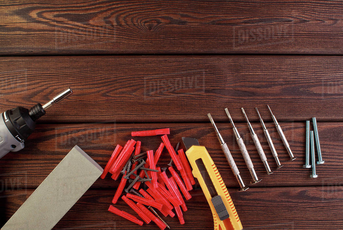 Tools worker, hammer, screwdriver, pliers on a wooden background, top view Royalty-free stock photo