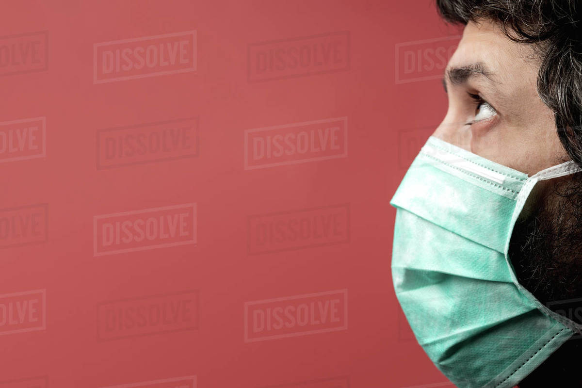 Man with mask, Covid-19 protection, coloured background Royalty-free stock photo