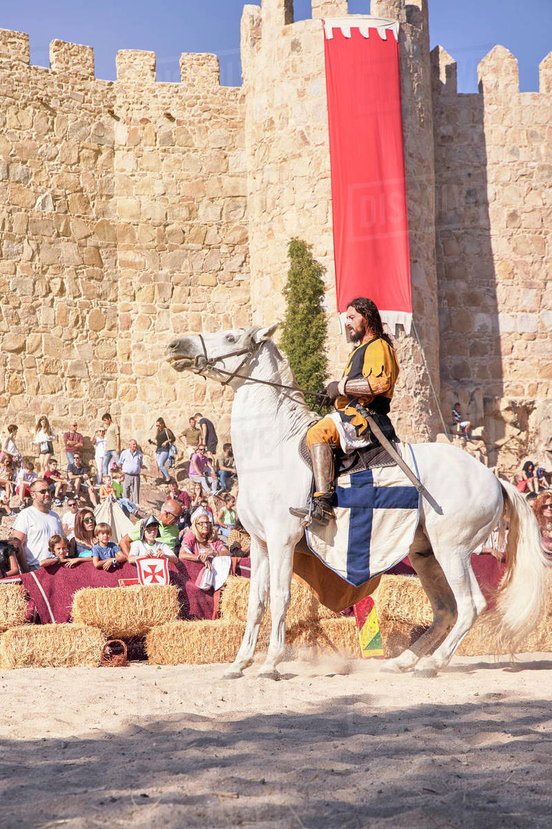 Medieval knight riding his horse next to the city walls during the medieval festivities. Avila, Spain Royalty-free stock photo