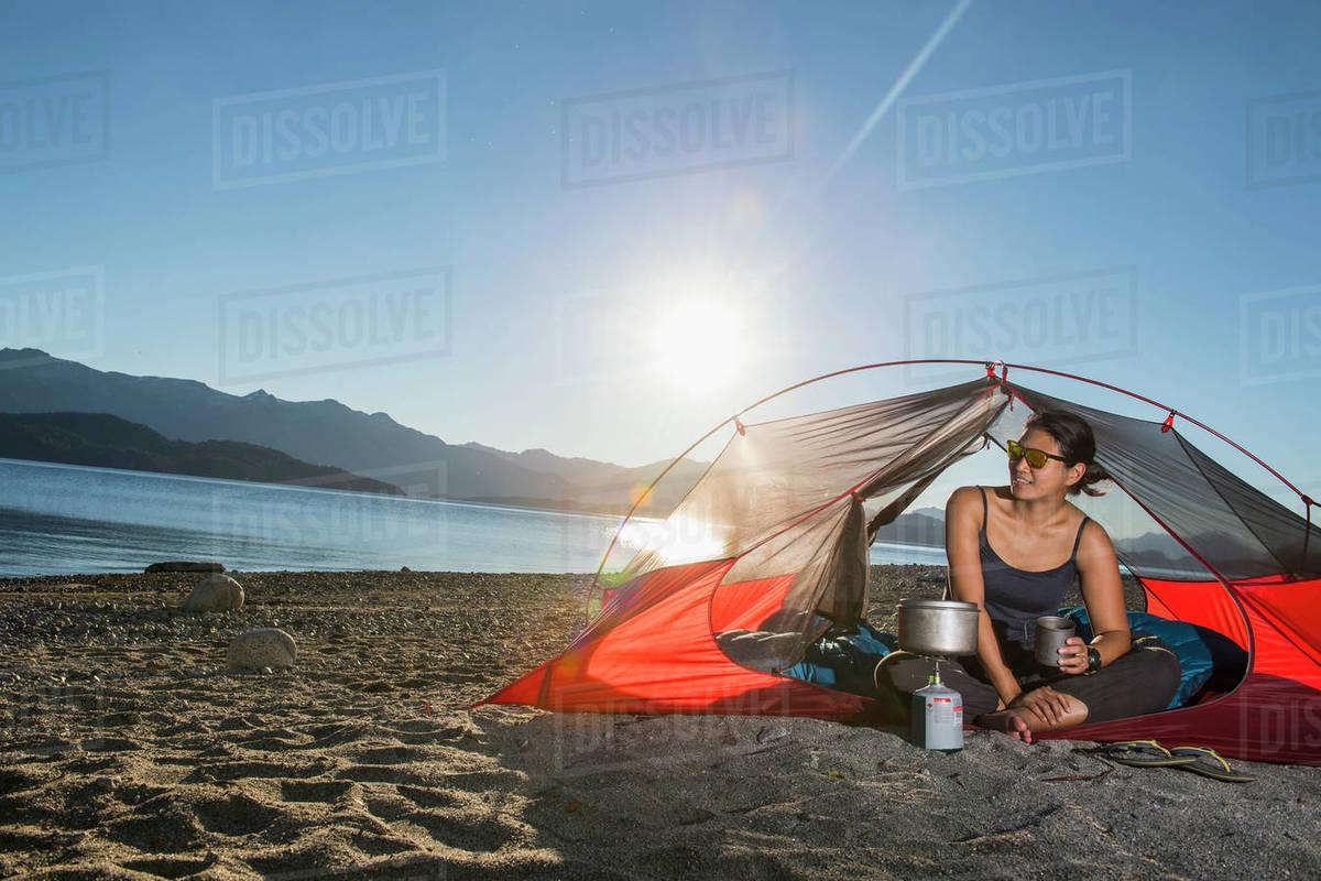Woman relaxing at camp at the Nahuel Huapi Lake in Patagonia Royalty-free stock photo