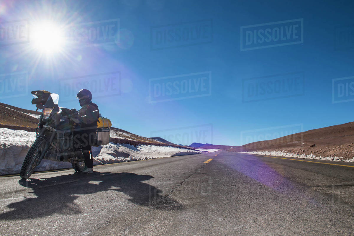 Woman standing next to her touring motorbike close to Paso de Jama Royalty-free stock photo