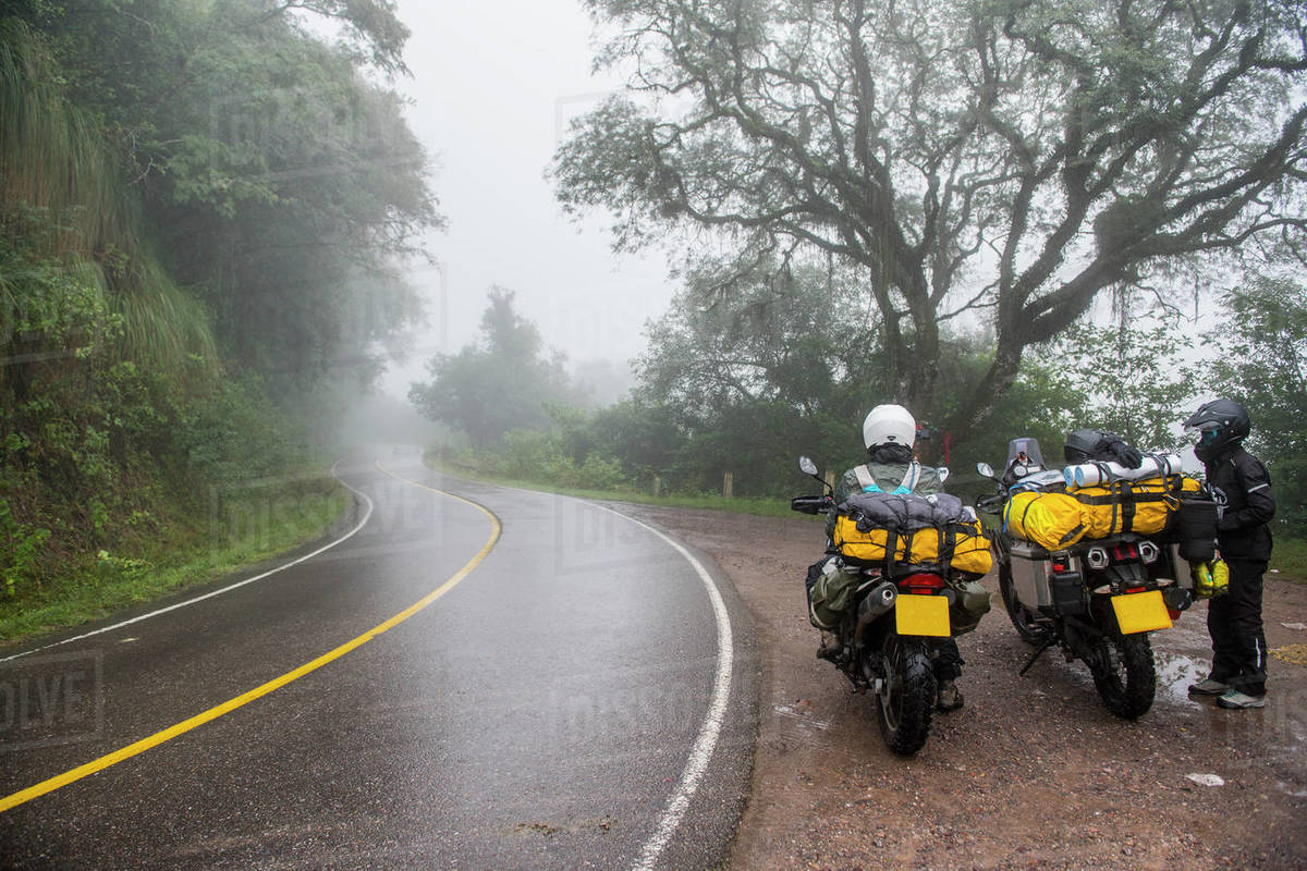 Two women with touring motorbikes in rain forest, Jujuy / Argentina Royalty-free stock photo