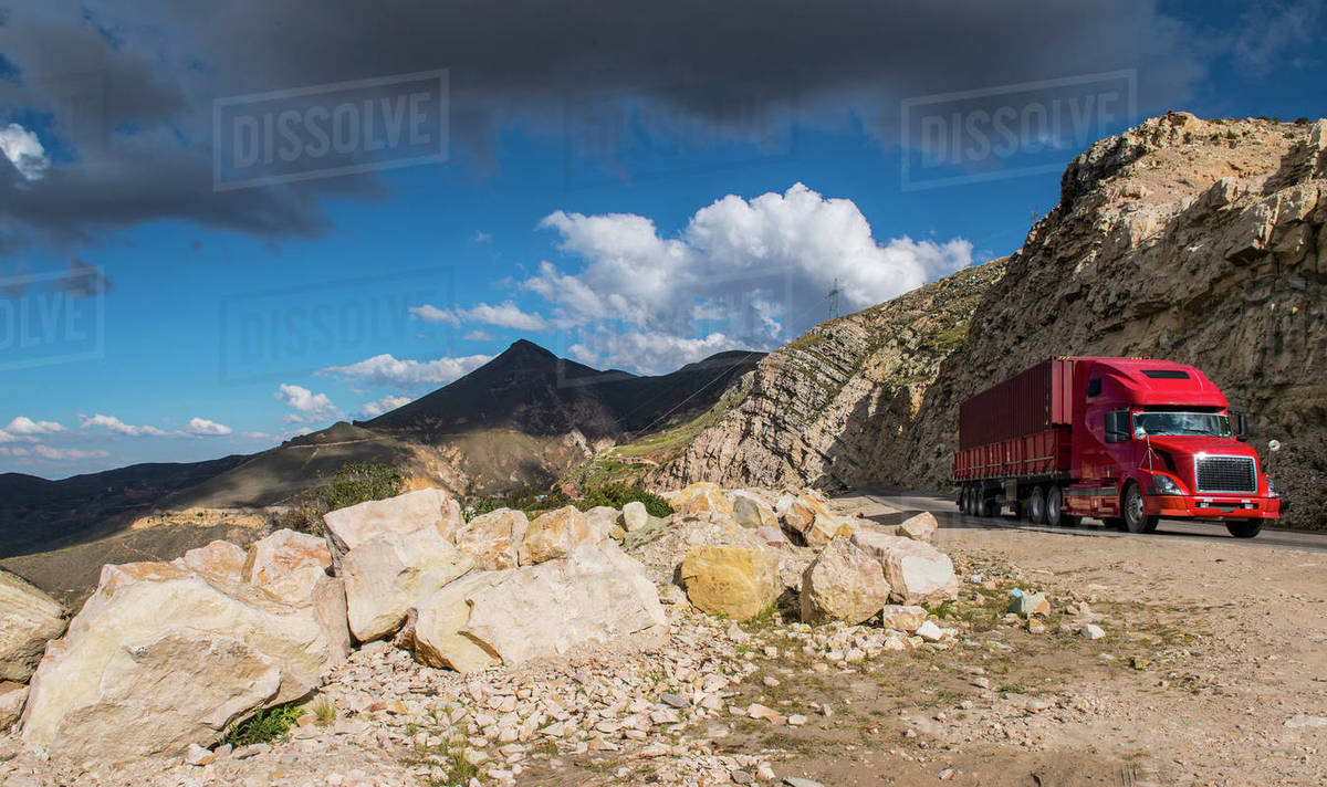 Red truck driving up a hill in Bolivia Royalty-free stock photo