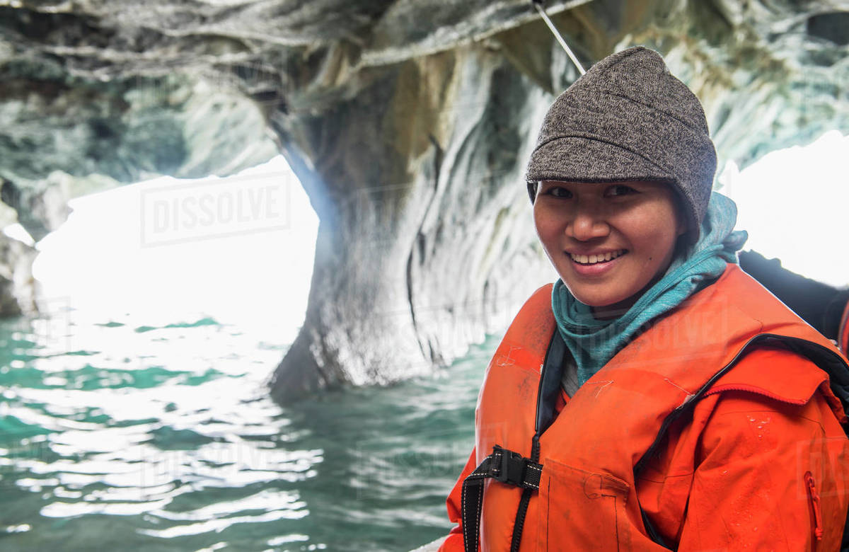 Woman admiring the marble caves, Catedral de Marmol, Chile Royalty-free stock photo