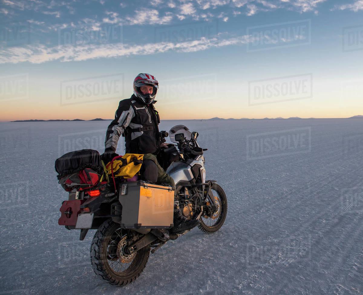 Man riding his touring motorbike on the salt flats of Uyuni in Bolivia Royalty-free stock photo