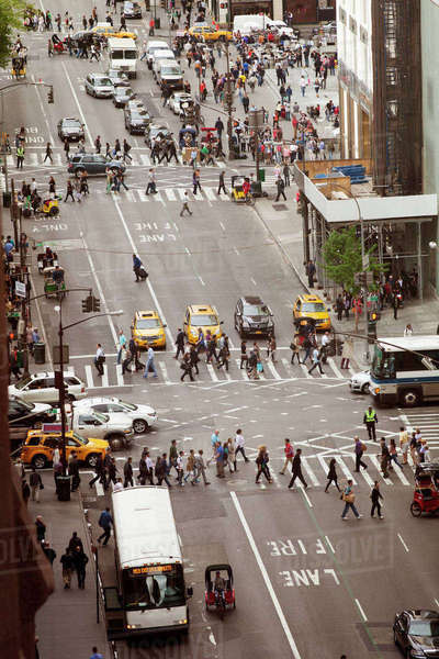 High angle view of people crossing city street Royalty-free stock photo
