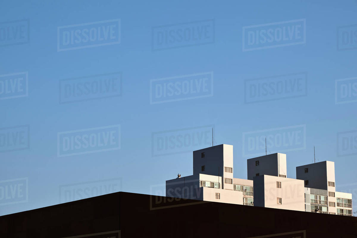 Modern Apartment Buildings Against a Blue Sky in the Morning Light Royalty-free stock photo
