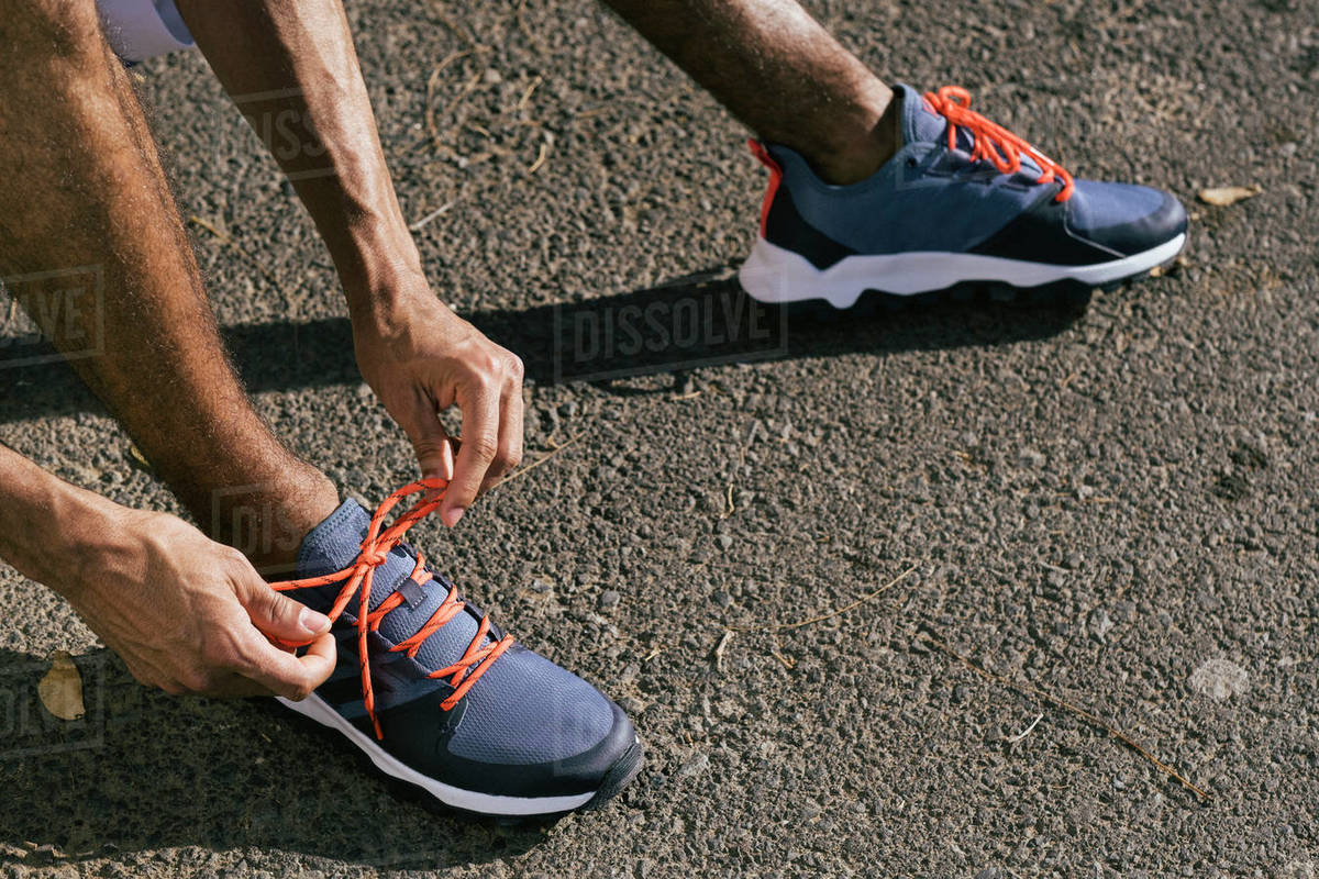 Close up of male athlete tying sport shoes shoelaces Royalty-free stock photo