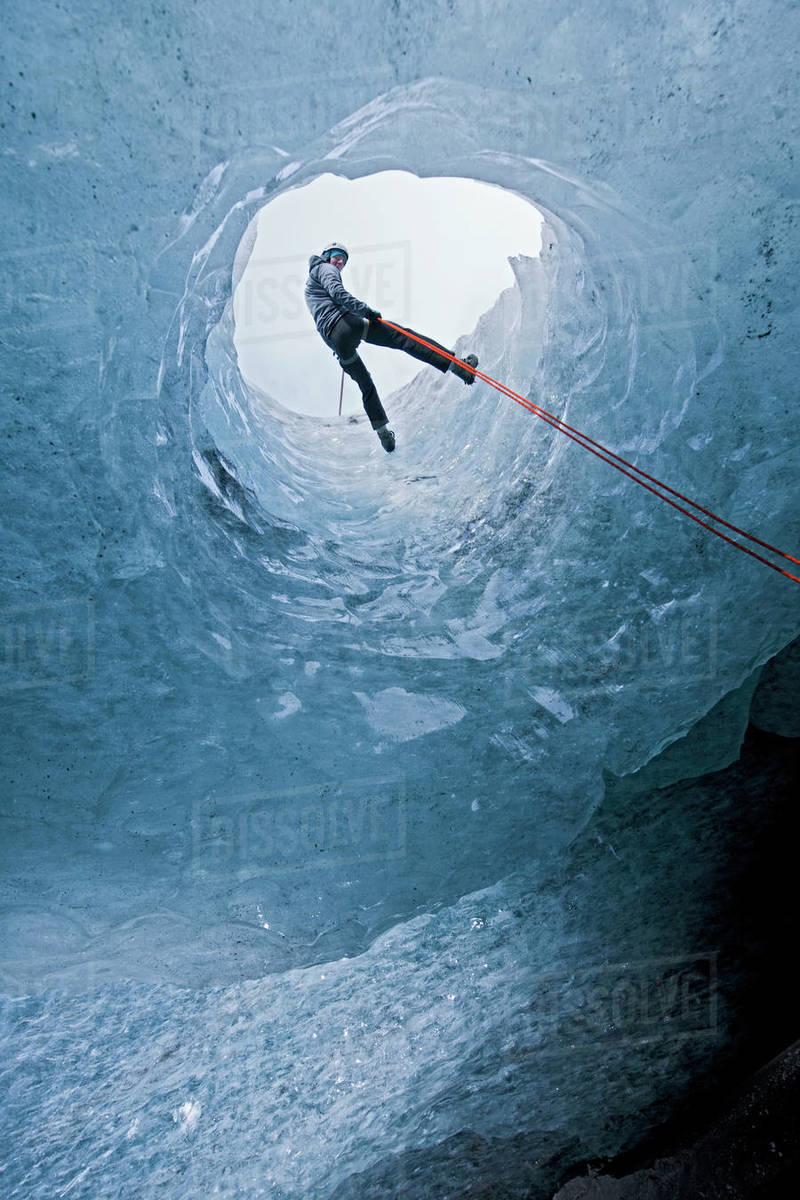 Man rappelling into glacier cave on Sólheimajökull glacier in Iceland Royalty-free stock photo