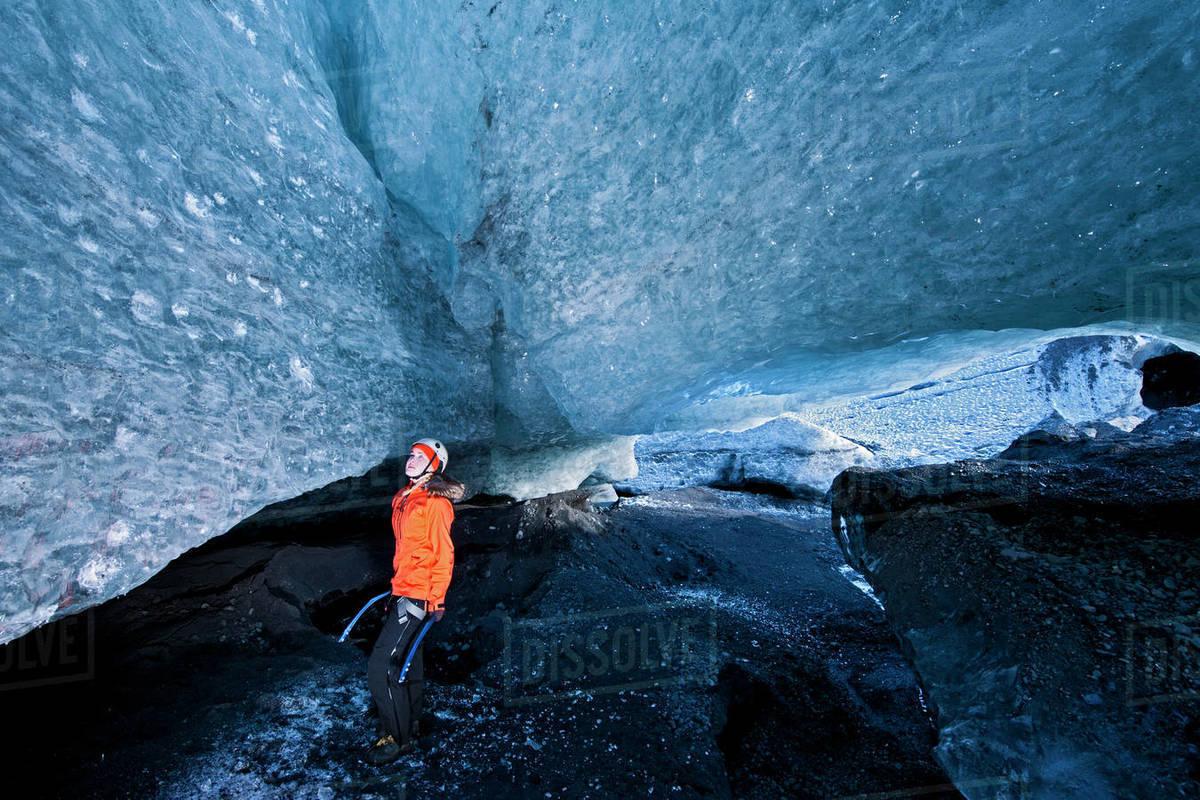 Woman exploring glacier cave at Sólheimajökull glacier in Iceland Royalty-free stock photo