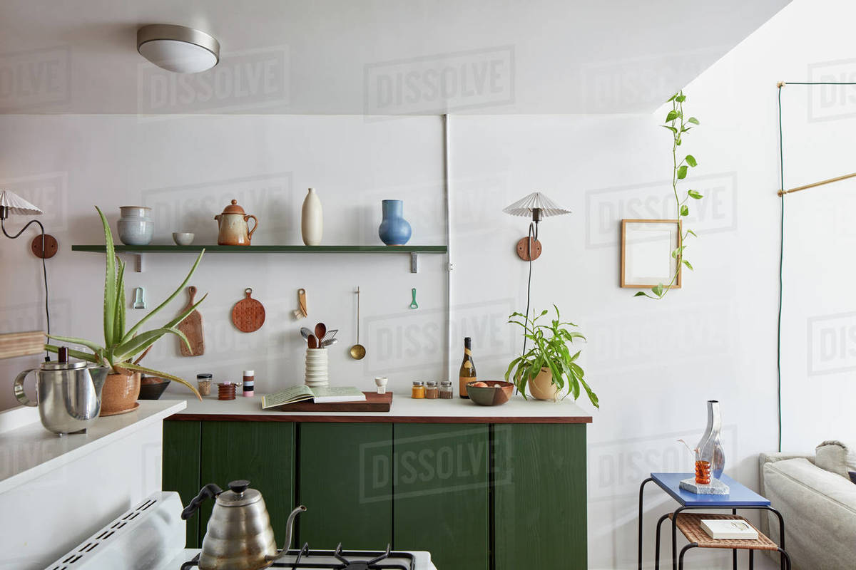 Interior of kitchen stove, counter with shelving, pottery, plants Royalty-free stock photo