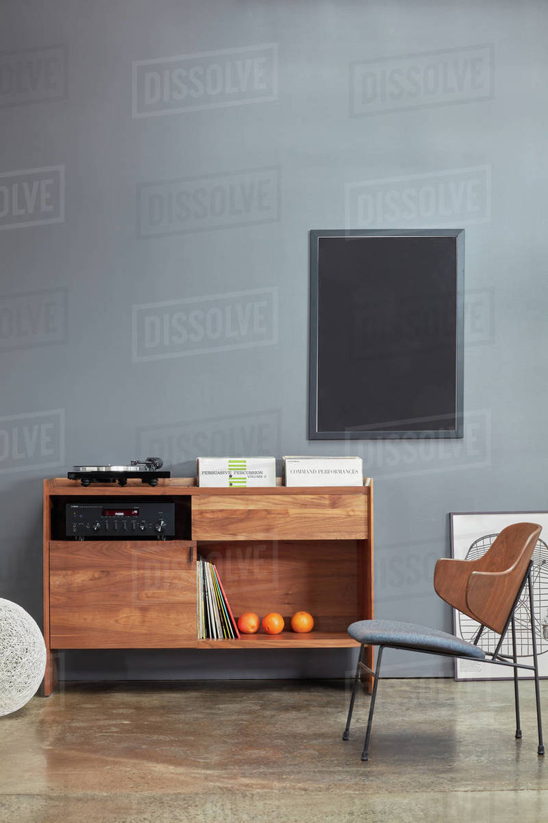 Custom wood stereo cabinet against grey wall Royalty-free stock photo