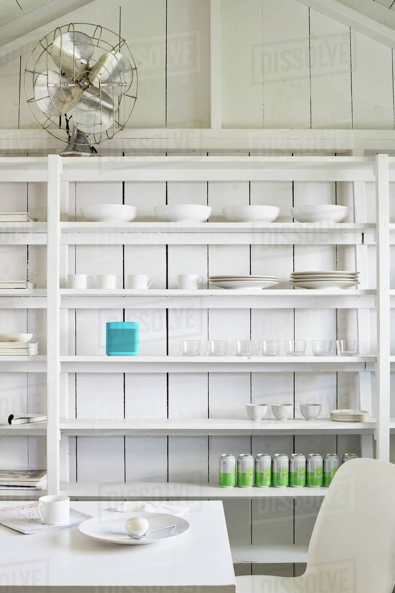 Organized shelving in clean, white shed Royalty-free stock photo