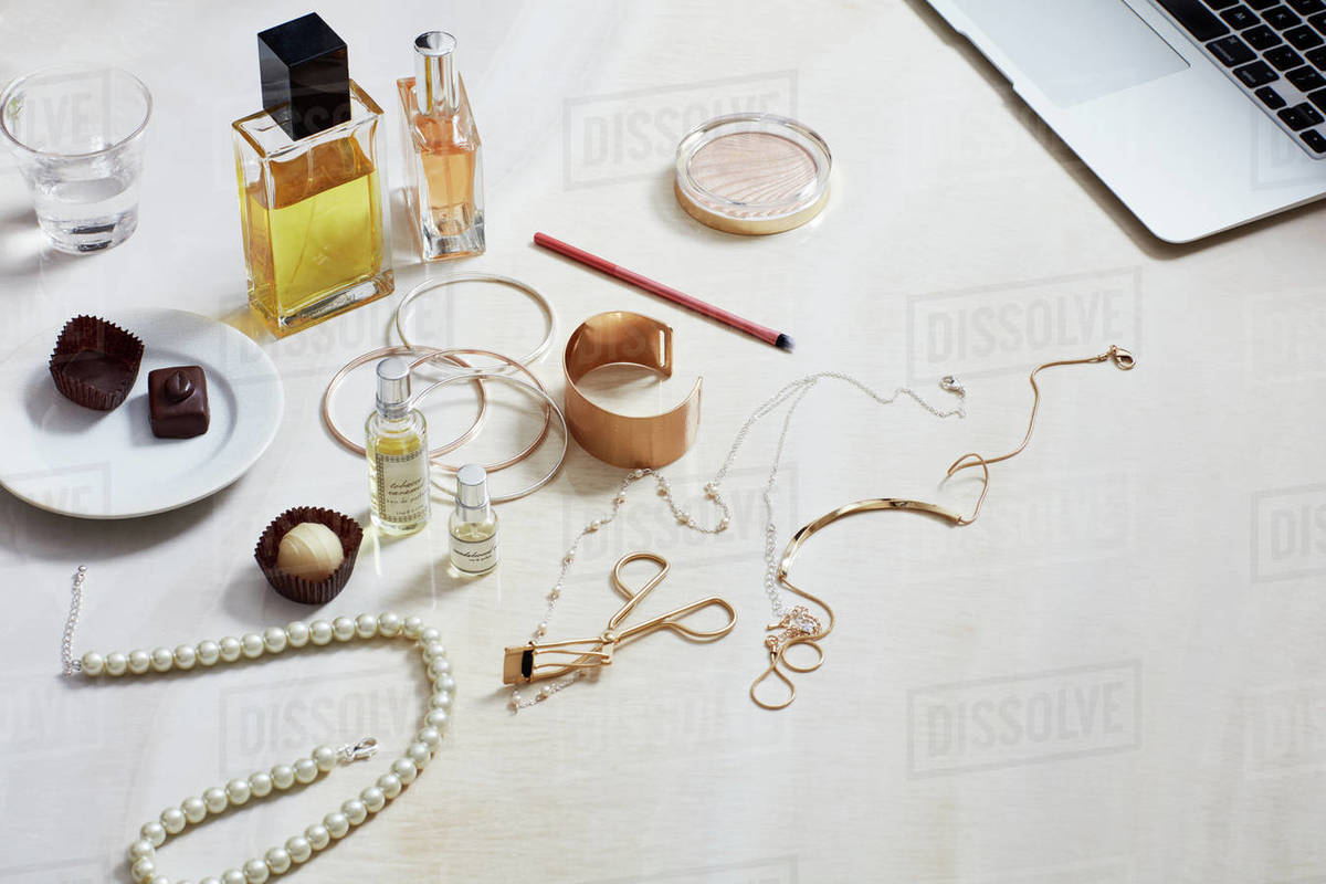 Still life with fashion accessories, computer, perfume Royalty-free stock photo
