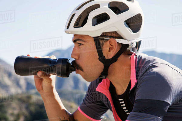Close-up of mountain biker drinking from bottle Royalty-free stock photo