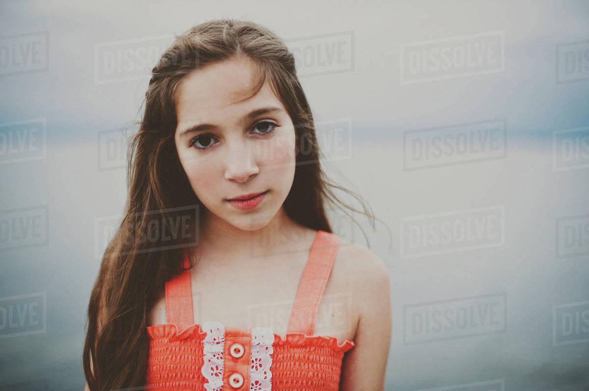 Portrait of confident girl by sea Royalty-free stock photo